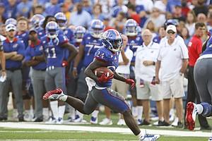Kansas running back Taylor Martin (24) looks for room during the first quarter on Saturday, Sept. 2, 2017 at Memorial Stadium.