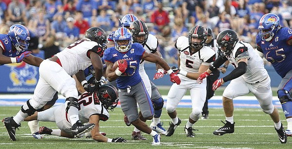 Kansas running back Dom Williams (25) breaks away from the Redhawks defense during the second quarter on Saturday, Sept. 2, 2017 at Memorial Stadium.