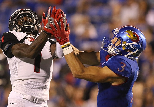 Southeast Missouri cornerback Al Young (1) picks off a pass to Kansas wide receiver Chase Harrell (3) during the fourth quarter on Saturday, Sept. 2, 2017 at Memorial Stadium.
