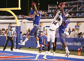 Several Jayhawks get up to bat down an end zone pass to Southeast Missouri wide receiver Trevon Billington (14) during the fourth quarter on Saturday, Sept. 2, 2017 at Memorial Stadium.