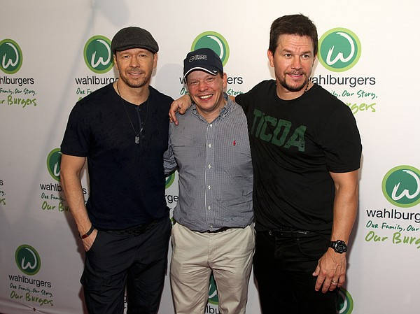 In this June 23, 2015, file photo, Donnie Wahlberg, from left, Paul Wahlberg and Mark Wahlberg attend the Wahlburgers Coney Island preview party in New York. (Photo by Andy Kropa/Invision/AP, File)