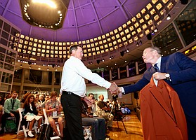 """Kansas basketball coach Bill Self receives his Hall of Fame jacket, with the color described as """"Naismith Orange,"""" during Naismith Memorial Basketball Hall of Fame media day Thursday, Sept. 7, 2017 in Springfield, Mass."""