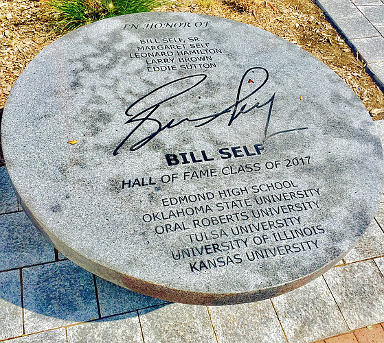 The Bill Self bench outside the entrance to the Naismith Memorial Basketball Hall of Fame has one small mistake that the Hall says soon will be fixed.