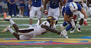Kansas tight end Ben Johnson slips past a CMU defender during the Jayhawks game against Central Michigan Saturday, Sept. 9 at Memorial Stadium.
