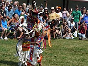 Jose Santos performs a grass dance at during Haskell student performances Saturday at the Haskell Indian Art Market.