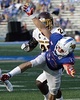 Kansas wide receiver Ryan Schadler (33) is bumped by CMU defensive back Josh Cox (21) during the Jayhawks game against Central Michigan Saturday, Sept. 9 at Memorial Stadium. Pass interference was called on Cox.