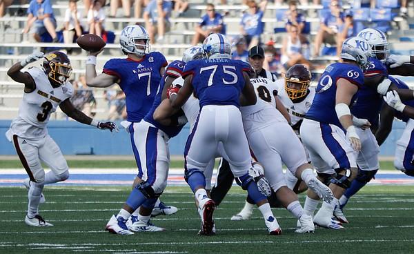 Kansas quarterback Peyton Bender (7) passes while under pressure from the CMU defense during the Jayhawks game against Central Michigan Saturday, Sept. 9 at Memorial Stadium.