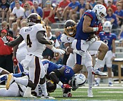 Kansas wide receiver Chase Harrell (3) attempts to pull away from defenders during the Jayhawks game against Central Michigan Saturday, Sept. 9 at Memorial Stadium.