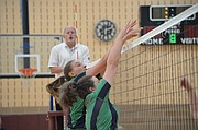 Bishop Seabury seahawks Lindsey Hornberger (10) and Britain Hamm (1) reach for the ball over the net during a game against Veritas Christian School. Veritas won 2-1 at the East Lawrence Recreation Center on Sept. 12, 2017.