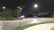 Several Lawrence police vehicles block off Overland Drive behind Walmart, 550 Congressional Drive, Tuesday, Sept. 12, 2017. An armed carjacking in Topeka resulted in a chase that ended behind the store. This photo looks east from the roundabout at Congressional and Overland drives.