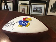 This football, signed by former Kansas football coach Mark Mangino, is one of the bigger ticket items at the Brandon Woods Bonanza on Saturday, Sept. 16. The sale will be from 10 a.m. to 4 p.m.