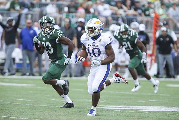 Kansas running back Khalil Herbert (10) takes off on a touchdown run past Ohio safety Kylan Nelson (23) during the second quarter on Saturday, Sept. 16, 2017 at Peden Stadium in Athens, Ohio.