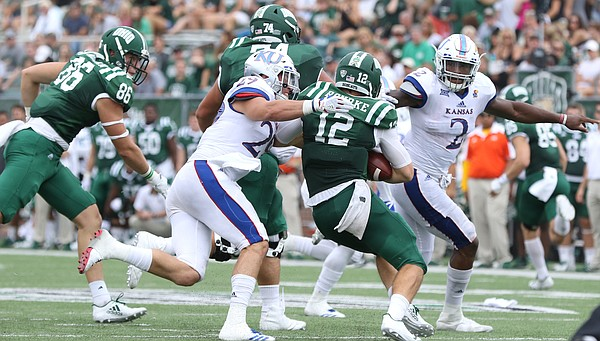 Kansas linebacker Joe Dineen Jr. (29) drags down Ohio quarterback Nathan Rourke (12) during the fourth quarter on Saturday, Sept. 16, 2017 at Peden Stadium in Athens, Ohio.