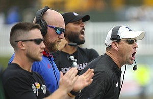 Kansas head coach David Beaty, right, screams from the sidelines during the third quarter on Saturday, Sept. 16, 2017 at Peden Stadium in Athens, Ohio.