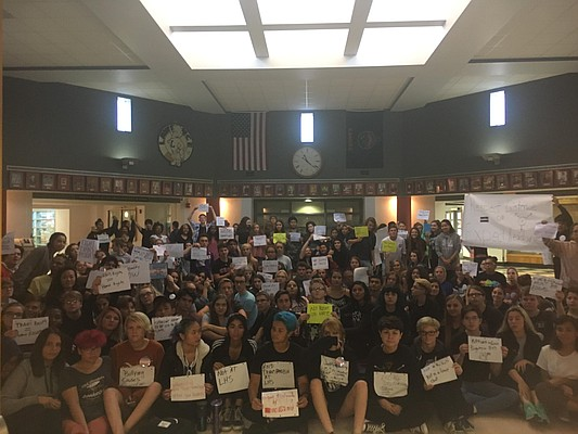 Lawrence High School students crowd the LHS rotunda on the morning of Sept. 18, 2017, in support of transgender rights and against what some described as a pervasive culture of transphobic behavior at the school. This photo was shared with the Journal-World by a student.