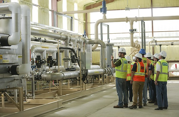 Visitors get a brief rundown of the inner workings of the new methane plant at the Hamm landfill north of Lawrence, Wednesday, Sept. 20, 2017.