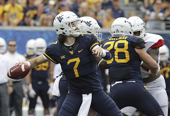 West Virginia quarterback Will Grier (7) attempts a pass during the second half of an NCAA college football game against Delaware State, Saturday, Sept. 16, 2017, in Morgantown, W.Va.