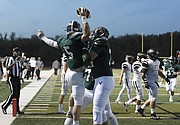 Free State senior quarterback Gage Foster celebrates a touchdown with offensive lineman Turner Corcoran during the team's win against SM Northwest on Friday at FSHS.