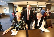 Tom Stutz gets a laugh out of Bonnie Dallas, left, and Margaret Seal upon his arrival at Pioneer Ridge Independent Living pub, 1000 Wakarusa, on Friday, Sept. 22, 2017.