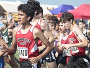 Lawrence High junior Derek White leads a pack of LHS runners in the first 400 meters of the varsity boys crimson division race of the Rim Rock Classic on Saturday at Rim Rock Farm. White helped the Lions to 38th place after finishing with a 5,000-meter time of 20:05.4.