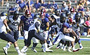 Kansas running back Khalil Herbert (10) tries to break away from the West Virginia defense during the first quarter on Saturday, Sept. 23, 2017 at Memorial Stadium.