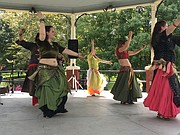 Raghsidad dancers perform a Middle Eastern dance at the annual Festival of Cultures Sunday afternoon in South Park.
