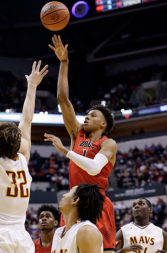 New Albany guard Romeo Langford (1) shoots over McCutcheon forward Haden Deaton (32) in the second half of the Indiana Class 4A IHSAA state championship basketball game in Indianapolis, Saturday, March 26, 2016. New Albany won 62-59. (AP Photo/AJ Mast)