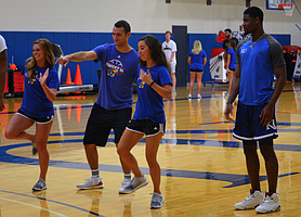 Men's basketball players Clay Young (left) and Malik Newman (right) work on their dance moves alongside Rock Chalk Dancers Katie Lomshek (left) and Kendall Zellars (right).