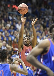 Kansas sophomore guard Malik Newman shoots a 3-pointer during the team's scrimmage in the 33rd-annual Late Night in the Phog on Saturday, Sept. 30, 2017 at Allen Fieldhouse.