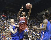Kansas junior guard Lagerald Vick goes up for a layup during the team's scrimmage in the 33rd-annual Late Night in the Phog on Saturday, Sept. 30, 2017 at Allen Fieldhouse.