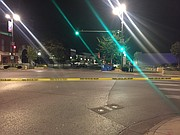 Crime scene tape stretches across the intersection of 11th and Massachusetts streets early Sunday morning after multiple reported shootings in downtown Lawrence.