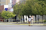 Investigators were busy working the scene of a multiple fatality shooting midday Sunday, Oct. 1, 2017. The entire intersection of 11th and Massachusetts streets was closed while investigators gathered evidence.