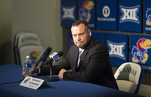 Kansas women's basketball coach Brandon Schneider talks with media members during Media Day on Wednesday, Oct. 4, 2017 at Allen Fieldhouse.
