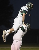 Free State senior quarterback Gage Foster is lifted up in the air by Jalan Robinson after a touchdown against Olathe Northwest on Thursday at College Boulevard Activity Center.