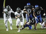 Free State junior running back Jax Dineen breaks past defenders on his way to a touchdown against Olathe Northwest on Thursday at College Boulevard Activity Center.