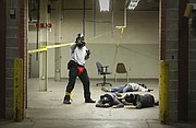 An officer in training secures an area during an active shooter training scenario in the former World Company press building at the corner of Sixth and New Hampshire streets on Wednesday, Oct. 4, 2017.