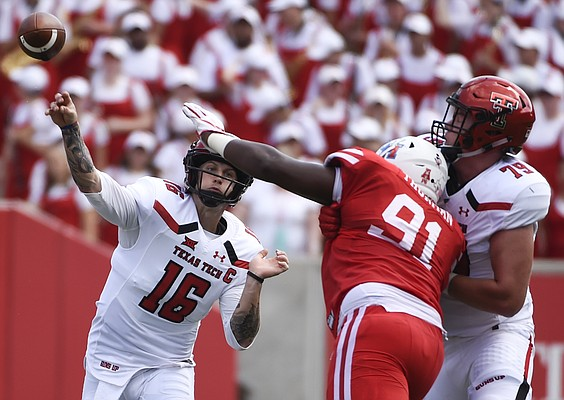 Texas Tech quarterback Nic Shimonek (16) throws a pass over Houston defensive end Nick Thurman (91) during the first half of an NCAA college football game, Saturday, Sept. 23, 2017, in Houston. (AP Photo/Eric Christian Smith)
