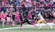 Lawrence High senior Ekow Boye-Doe secures a catch in the first quarter against Olathe South on Friday at LHS.