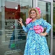 Drag queen Deja Brooks is pictured near the entrance of the Lawrence Public Library, 707 Vermont St. The library will host Deja's Reading Rainbow on Oct. 8.