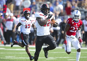 Texas Tech running back Desmond Nisby (32) runs up the field past Kansas safety Tyrone Miller Jr. (22) for a touchdown during the first quarter on Saturday, Oct. 7, 2017 at Memorial Stadium.