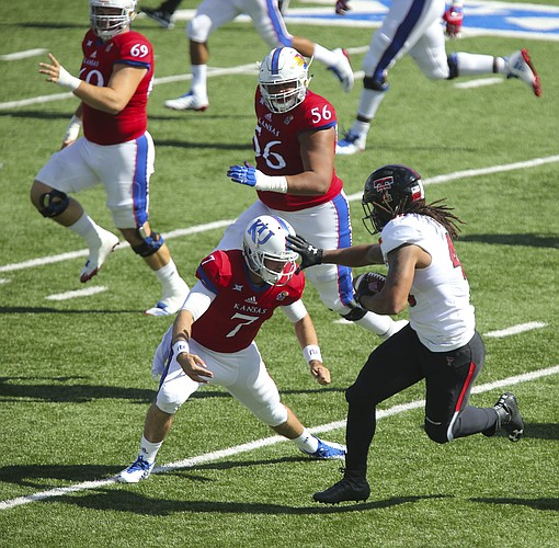 Texas Tech linebacker Dakota Allen (40) looks to stiff arm Kansas quarterback Peyton Bender (7) after intercepting a pass from Bender during the second quarter on Saturday, Oct. 7, 2017 at Memorial Stadium.