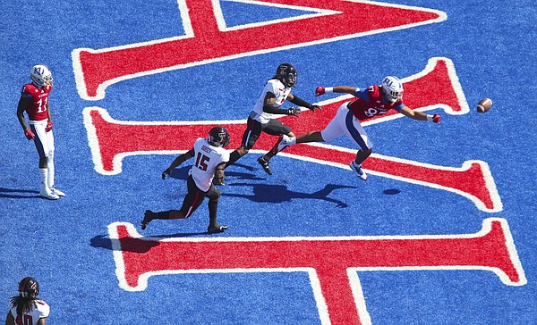 An end zone pass to Kansas tight end Earl Bostick Jr. (87) goes wide late during the second quarter on Saturday, Oct. 7, 2017 at Memorial Stadium.