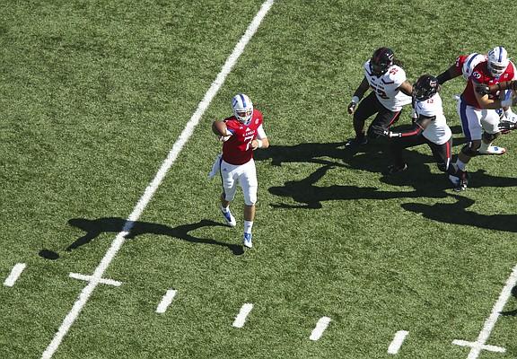 Kansas quarterback Peyton Bender (7) throws during the second quarter on Saturday, Oct. 7, 2017 at Memorial Stadium.