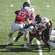 Texas Tech running back Tre King (24) is brought down by Kansas linebacker Keith Loneker Jr. (47) during the second quarter on Saturday, Oct. 7, 2017 at Memorial Stadium.