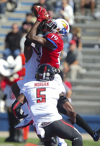 Kansas wide receiver Evan Fairs (19) has a pass in the end zone knocked away by Texas Tech defensive back D.J. Polite-Bray (3) and Texas Tech defensive back Octavious Morgan (5) during the third quarter on Saturday, Oct. 7, 2017 at Memorial Stadium.
