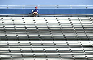 A Kansas fan looks through the game program during the fourth quarter from the top of the stands on Saturday, Oct. 7, 2017 at Memorial Stadium.