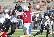 Texas Tech defensive lineman Kolin Hill (13) dives in to hit Kansas quarterback Carter Stanley (9) after a pass during the fourth quarter on Saturday, Oct. 7, 2017 at Memorial Stadium.