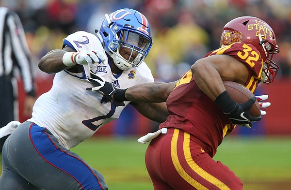 Kansas defensive end Dorance Armstrong Jr. (2) comes in to wrap up Iowa State running back David Montgomery (32) during the first quarter on Saturday, Oct. 14, 2017 at Jack Trice Stadium in Ames, Iowa.