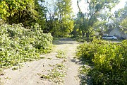 The 400 block of Lincoln Street was one of three North Lawrence streets still blocked Sunday morning from downed trees and tree limbs. Dave Kraus, city street field supervisor, said city crews worked from 5 p.m. to midnight Saturday to remove debris from streets following the storm.