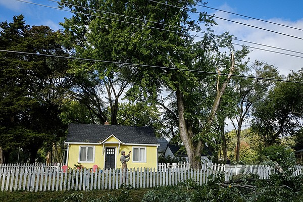 A homeowner surveys the damage to his property at Seventh and Lyon streets, Sunday, Oct. 15, 2017, following severe storms the night before.